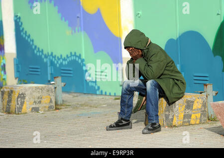 Munich, Germany. 31st Oct, 2014. A refugees from Eritrea sits at the reception center for asylum seekers on the - Stock Photo