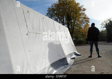 Munich, Germany. 31st Oct, 2014. A refugees stands at the reception center for asylum seekers on the Bavaria Barracks - Stock Photo