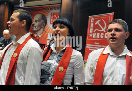 Minsk, Belarus. 1st Nov, 2014. Young people sing at the 35th Congress of the Communist Parties Union. © Viktor Drachev/TASS/Alamy - Stock Photo
