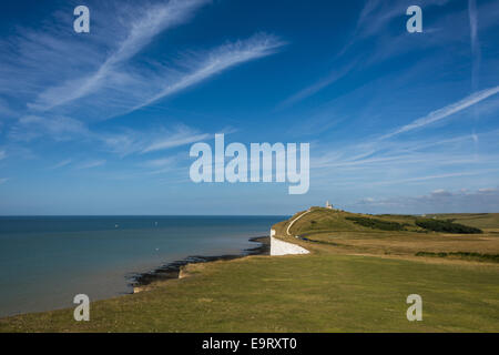 Looking across the chalk headland and cliffs of Beachy Head to Belle Tout Lighthouse on England's south coast, East - Stock Photo