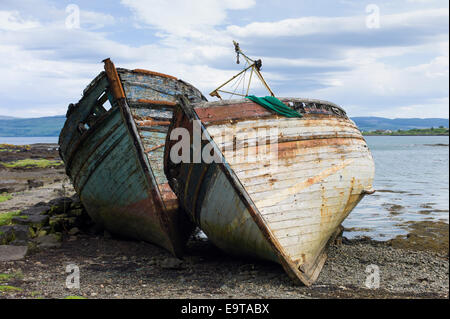 Disused rusty derelict fishing boats at Salen Bay in Sound of Mull on Isle of Mull in the Inner Hebrides and Western - Stock Photo