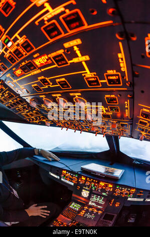 Cockpit of an Airbus A320 flight simulator that is used for training of professional airline pilots (during 'flight') - Stock Photo