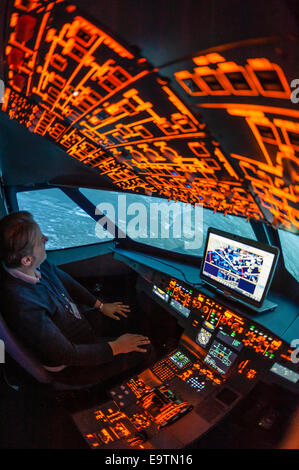 Cockpit of an Airbus A320 flight simulator that is used for training of professional airline pilots (during 'flight'). - Stock Photo