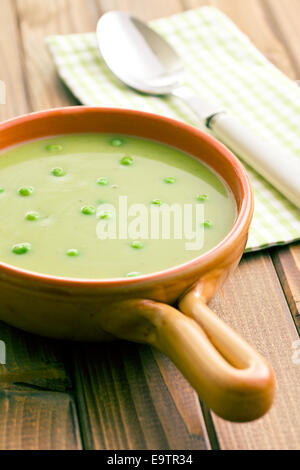 the pea soup in ceramic bowl - Stock Photo