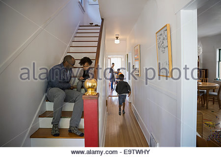 Family on stairs and in hallway - Stock Photo