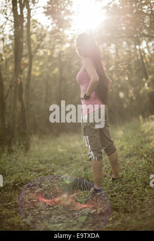 Young woman, sportive, in forest (model-released) - Stock Photo