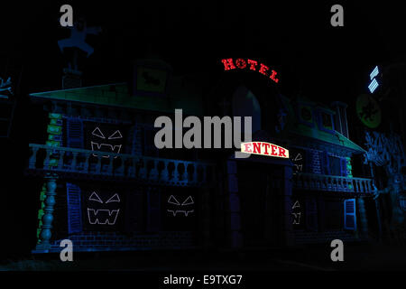 NIght oblique view green purple Haunted Hotel Tableau, with white neon lights and spooky images, Blackpool Illuminations, - Stock Photo