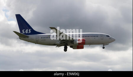 SAS Scandinavian Airlines Boeing 737 (LN-RRN), landing to Manchester International Airport. - Stock Photo