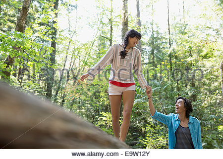 Couple holding hands in woods - Stock Photo