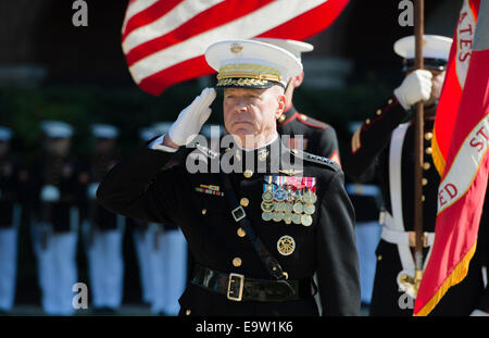 U.S. Marine Corps Gen. James F. Amos, the outgoing commandant of the Marine Corps, salutes during a change of command and retirement ceremony at Marine Barracks Washington in Washington, D.C., Oct. 17, 2014. Amos formally relinquished command of the Marin Stock Photo