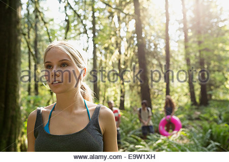 Serious young woman in woods - Stock Photo