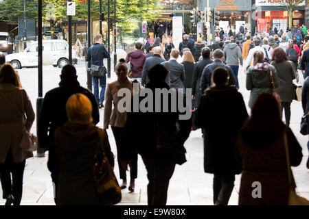 Commuters walking out of Snow Hill railway station towards the centre of Birmingham - Stock Photo