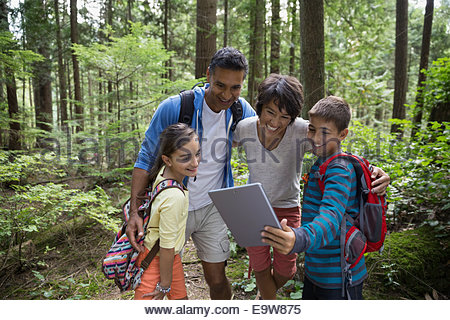 Family taking selfie with digital tablet in woods - Stock Photo