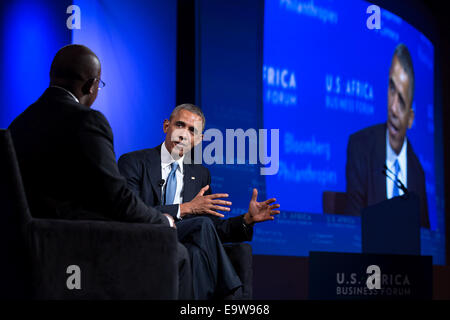 President Barack Obama participates in a discussion with moderator Takunda Chingonzo at the U.S.-Africa Business - Stock Photo