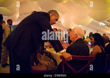 President Barack Obama talks with former President Jimmy Carter during the U.S.-Africa Leaders Summit dinner on the South Lawn of the White House, Aug. 5, 2014. Ph