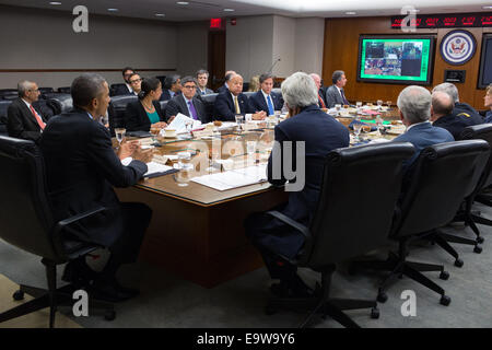 President Barack Obama, with Secretary of State John Kerry, participates in a secure video teleconference with Embassy - Stock Photo