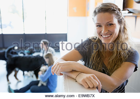 Portrait of confident dog daycare owner - Stock Photo