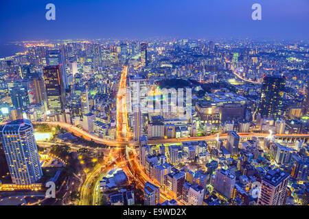 Tokyo, Japan cityscape at dusk above highway junction.