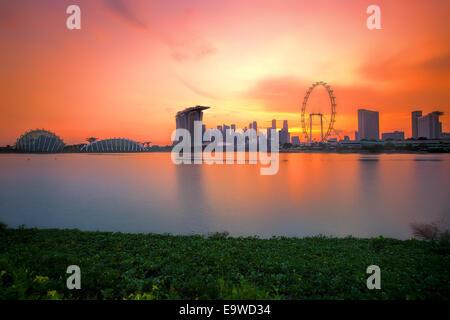 Singapore Skyline at sunset - Stock Photo