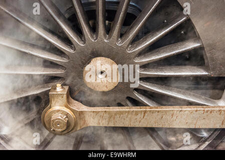 Steam surrounds a drive wheel of the steam engine train, Oliver Cromwell. Steam train is a Britannia Class 7MT 4 - Stock Photo