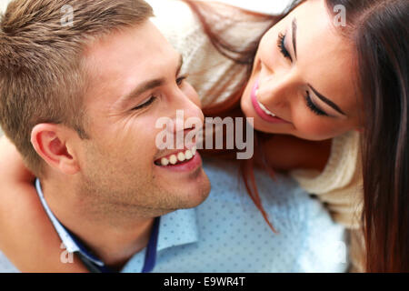 Closeup portrait of a smiling couple - Stock Photo