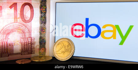 Berlin, Germany. 22nd Oct, 2014. ILLUSTRATION - A 10 euro banknote, 1 euro coin and an iPhone 6 displaying the Ebay - Stock Photo