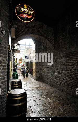 Merchants Arch in Dublin, Ireland. Running from Ha'Penny Bridge to Temple Bar. A Guinness logo can be seen. - Stock Photo