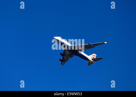 British Airways Boeing 747-436 from underneath against blue sky with undercarriage down