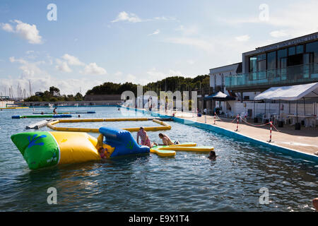 People having fun at Lymington open air sea water swimming baths - Stock Photo