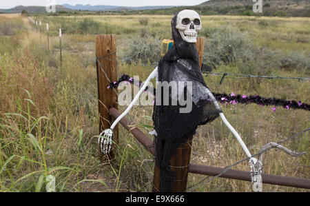 Masks used as Halloween decoration at ranch entrance in West Texas, south of Alpine. - Stock Photo