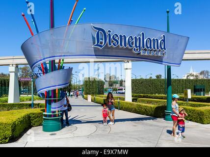 Tourists posing for photographs a the entrance to Disneyland Resort, Anaheim, Orange County, near Los Angeles, California, - Stock Photo