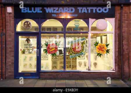 High Street tattooing. The new shop-front of the Blue Wizard Tattoo parlour in Dorchester. Such places are popping - Stock Photo