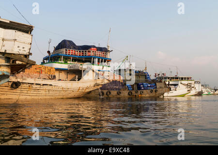 Pinisi, traditional two masted wooden cargo sailing ships moored in Sunda Kelapa Harbour, Jakarta, Java Island, - Stock Photo