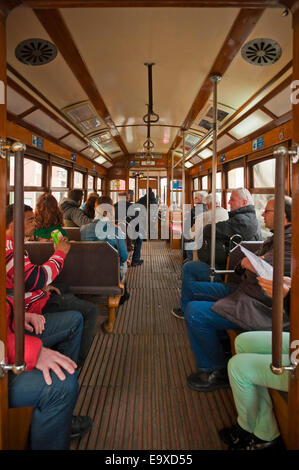 Vertical view of the inside of the traditional old yellow tram in Lisbon. - Stock Photo
