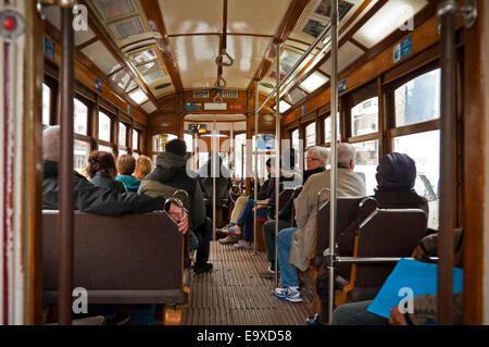 Horizontal view of the inside of the traditional old yellow tram in Lisbon. - Stock Photo