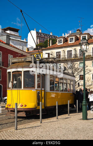 Vertical streetview of the traditional yellow tram in Lisbon. - Stock Photo