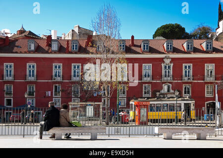 Horizontal streetview with the traditional yellow tram in Lisbon. - Stock Photo