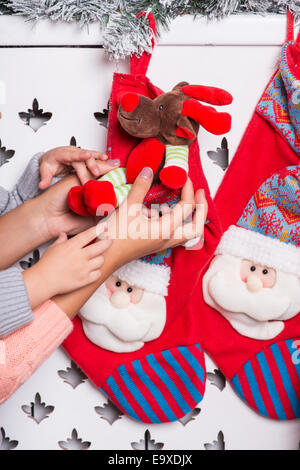 Mom and daughter preparing for Christmas - Stock Photo