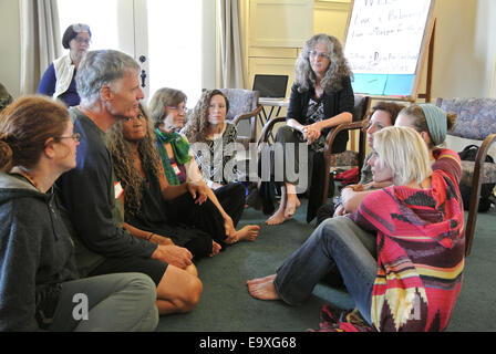 adult in group therapy constellation workshop interact with others at Esalen Institute in Big Sur California - Stock Photo