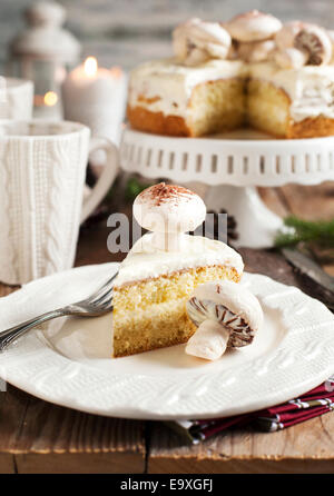 Vanilla Cake decorated with meringue mushrooms - Stock Photo