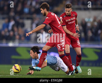 Roma, Italy. 3rd Nov, 2014. Stefano Mauri (L) of Lazio vies with Luca Rossettini of Cagliari during their Serie - Stock Photo