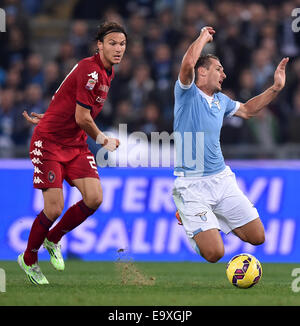 Roma, Italy. 3rd Nov, 2014. Miroslav Klose (R) of Lazio vies with Albin Ekdal of Cagliari during their Serie A football - Stock Photo