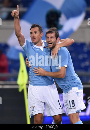 Roma, Italy. 3rd Nov, 2014. Miroslav Klose (L) of Lazio celebrates for his goal with teammate Senad Lulic during - Stock Photo