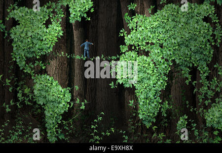Global growth risk business concept as a businessman walking on a tightrope made from plant vines in a background - Stock Photo