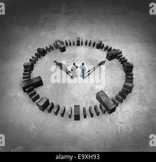 Business time concept as two businessman standing in the middle of a sundail clock with their cast shadows as hour - Stock Photo