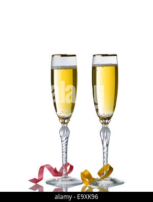 Elegant drinking glasses filled with golden champagne isolated over white background with reflection and party ribbons - Stock Photo