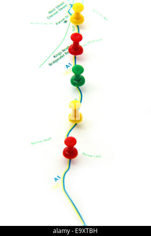 Route planning on map with pushpins. - Stock Photo