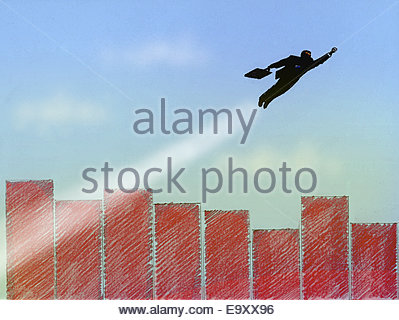 Superhero businessman flying above bar graph city - Stock Photo