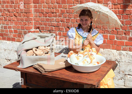 Girl in traditional dress outside the Pastry Museum in Kolomna, Russia - Stock Photo