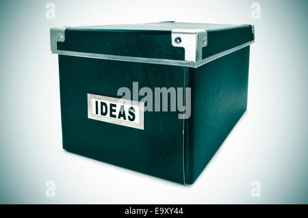 a black cardboard storage box with the word ideas written in the index card - Stock Photo